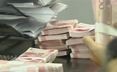 a-counting-money-bills-at-bank