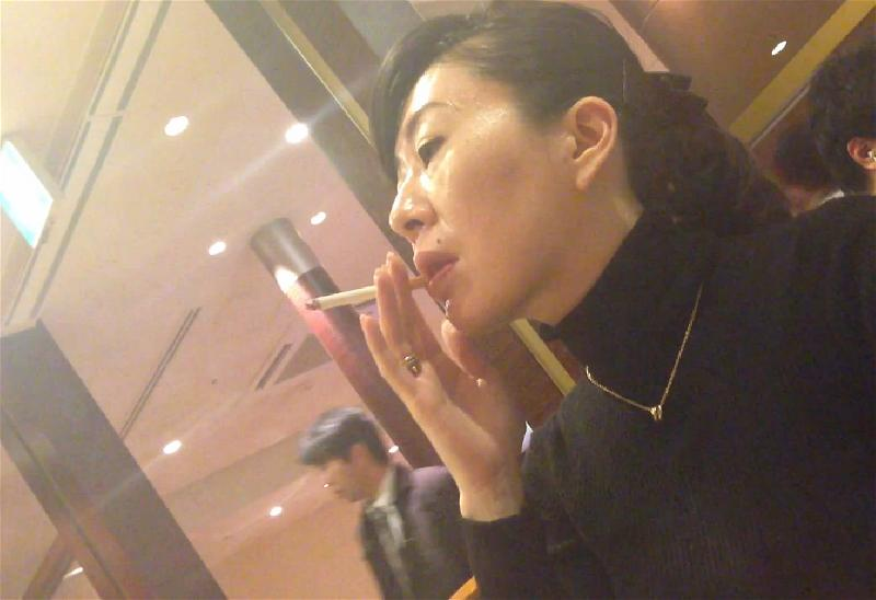 a-asian-lady-smoking