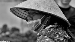 cone-hat-mask-facemask-coronavirus-covid-vietnamese-woman-worry-danger