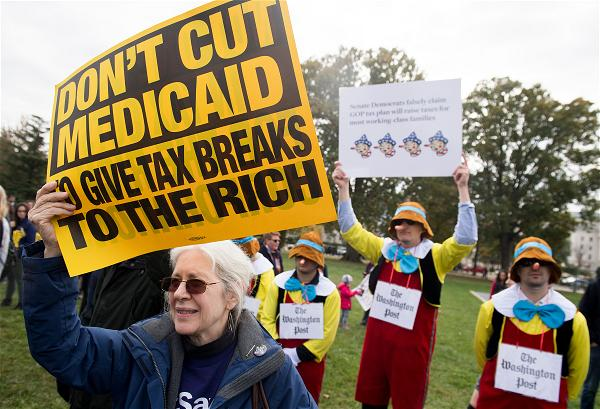 _AFP_protest tax cut for Medicaid