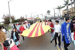 tetparade-2020-students-with-vietnamese-flag