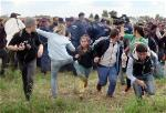 afp-hungary-tv-woman-kicking