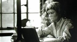 1-iris-murdoch-writing-at-her-oxford-home-in-1958