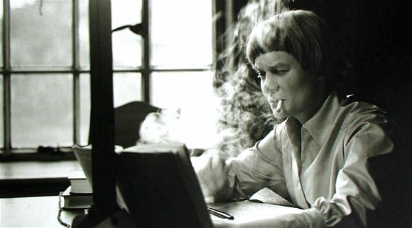 1) Iris Murdoch writing at her Oxford home in 1958