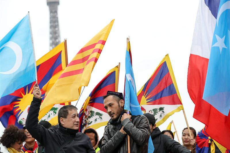 _AFP_protest china vietnam Tibet Uighur